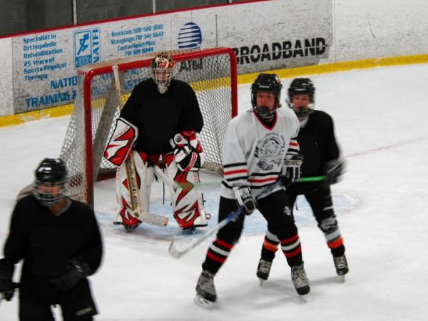 A Hockey Defenseman's Slot Coverage